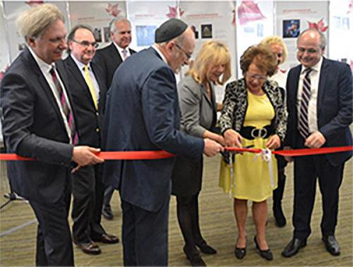 Ribbon-cutting at the launch of the new Canadian Jewish Experience (CJE) located at 30 Metcalfe Street. Exhibition open daily 9 a.m. - 6 p.m.. From left to right: Dr. Mark Kristmanson, CEO of the National Capital Commission; Supreme Court Justice Michael J. Moldaver; Ottawa Police Chief Charles Bordeleau; Rabbi Reuven Bulka, Rabbi Emeritus of Machzikei Hadas Synagogue; Mrs. Catherine Bélanger, widow of the late Member of Parliament Mauril Belanger; Tova Lynch, chair of CJE; Linda Kerzner, chair, Jewish Federation of Ottawa; Cantor Daniel Benlolo of Congregation Kehilat Beth Israel.